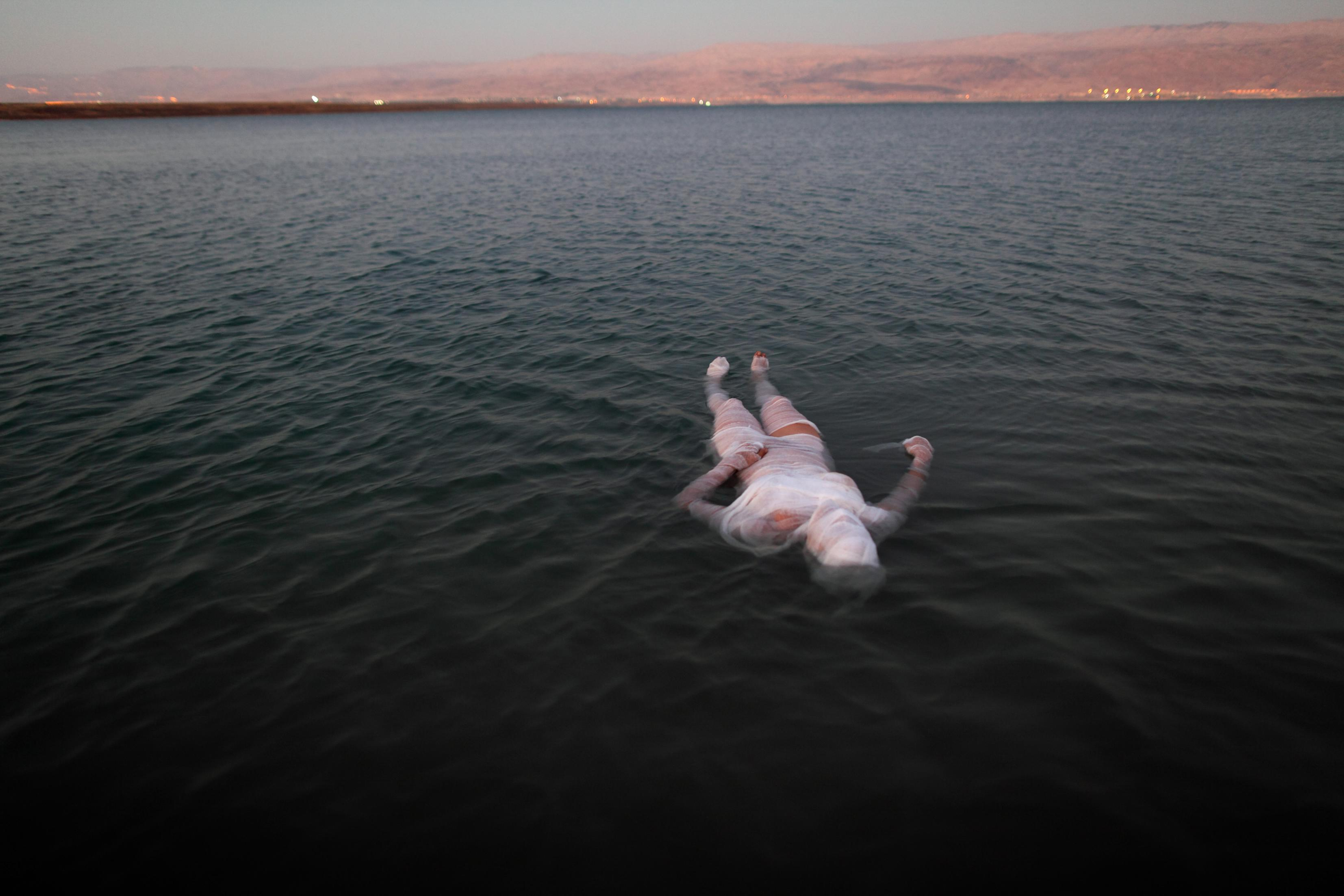 Ariane Littman,Sea of Death 2010,Performance at the Dead Sea, video, Photograph_Jim Hollander